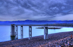 Turbulent Skies at Dawn, Chatfield Dam, Littleton, Colorado (Thad Roan - Bridgepix) Tags: statepark park bridge blue lake mountains water clouds sunrise landscape dawn scenery colorado footbridge dam denver reservoir chatfield hdr littleton photomatix chatfieldstatepark chatfielddam 200704 abigfave outlettower