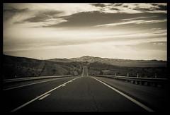 Destiny (Ledio (mostly away)) Tags: road arizona bw sepia d50 landscape nikon desert lasvegas mojave mojavedesert peisazh nikonstunninggallery howmanymoresupercoolcommentscanihave fshpeisazh