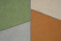 Wall Covering (sonofsteppe) Tags: urban orange house abstract building green art texture wall architecture composition facade concrete construction hungary exterior finding flat pastel budapest gray cement surface plaster structure s