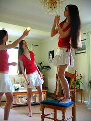 How Many Bellatrixes Does it Take to Change a Lightbulb? (Grace's Tophography) Tags: red green girl lightbulb bulb three cool chair room joke teen clone effect affect bellatrix flickrchallengegroup