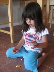 Olivia stringing beads