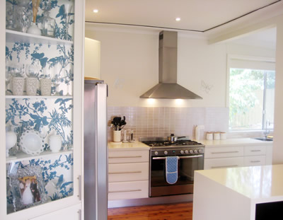 ish and chi wallpapered kitchen display cabinet interior design