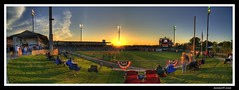 Play Ball! (sunsurfr) Tags: blue sunset sky people panorama building green grass yellow architecture clouds photoshop lights colorful downtown baseball stadium pano alabama structure explore biscuits montgomery fans d200 players hdr scoreboard stands rightfield photomatix tonemapping nikonstunninggallery biscuitsbaseball sunsurfr
