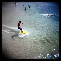The Yellow Board (Ralph Krawczyk Jr) Tags: blue motion 6x6 water swimming mediumformat hawaii oahu action toycamera shoreline squareformat honolulu bodyboard holga120n splishsplash kuhiobeachpark lifeobserved goteamholga ralphkrawczykjr