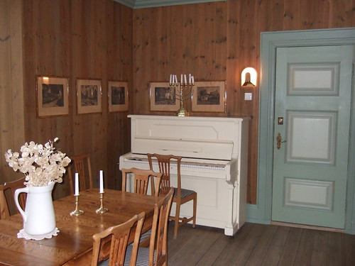 White upright piano in a shabby chic space