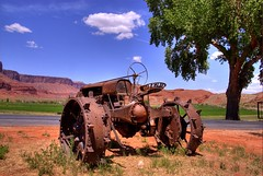 Rusty Tractor, Moab, Utah (Thad Roan - Bridgepix) Tags: ranch blue sky tractor mountains tree clouds vintage landscape utah rust sandstone scenery traktor farm rusty historic resort redrocks moab castlevalley blueribbonwinner 200705 redrockcountry sorrelriverranch diamondclassphotographer