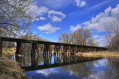 Railroad Trestle, Fort Collins, Colorado (Thad Roan - Bridgepix) Tags: wood railroad trestle bridge blue trees sky reflection water clouds river colorado bridges fortcollins hdr bridging photomatix bridgepixing bridgepix 200704 mywinners