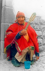 Contrast (visualkreator) Tags: travel red bw man color art peru southamerica cuzco contrast photoshop work cutout shoes colours hand arm legs cusco guitarra poor bn inka misery poncho hdr incas peruvian flickrsbest anawesomeshot aplusphoto