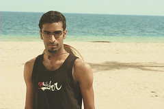 Saher,allil (Nasser Bouhadoud) Tags: sea portrait man beach look sunglasses canon lost eos 350d resort pure oakley nasser qatar quiksilver sealine saher  allil
