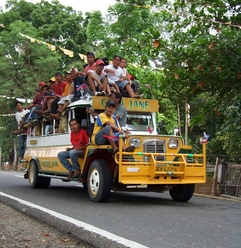 Lambunao, Iloilo, Philippines jeep transport commuting front right people overloaded pinoy