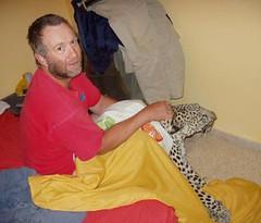 Man wrestles leopard
