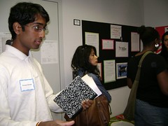 Presenter Praveen Savalgi discusses his poster with a member of the audience. 2007 University Writing and Research Symposium.
