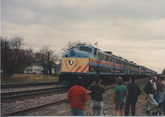 Three EMD E-8 passenger locomotives performing a photo runby near Harvard Illinois. Photographed during the C&NW /Metra  EMD E-8 Last Run fantrip from Chicago to Harvard Illinois.