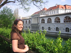 Sheri in front of the river with the market in the background