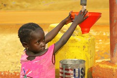 Fetching water (LindsayStark) Tags: africa travel girl children war sierraleone conflict humanrights humanitarian displaced idpcamp refugeecamp idps idp humanitarianaid emergencyrelief idpcamps waraffected