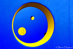 Yellow Circles (Steve Hopson) Tags: blue windows abstract color window architecture austin airport texas geometry circles peekaboo perspective holes crescent austintexas dell maze forms publicart labyrinth seton primarycolors primarycolours crescentmoon 1000views throughthelookingglass concentriccircles mueller justaskaliceithinkshellknow blueandyellow childrenshospital healingcenter childrensmedicalcenter robertmuellerairport dcmc healinggarden childrensmaze dellchildrenshospital rainbowweek dellchildrenshospitalplayscape childrenshospitals dellchildrensmedicalcenter dellchildrensmedicalcenterofcentraltexas childrenslabyrinth dellchildrensmedicalcenterlabyrinth dellchildrenslabyrinth tbgpartners peekaboowall muellerneighborhood