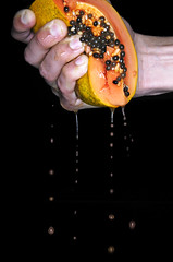 Papaya (yospyn) Tags: food fruit hands juice creative papaya squeeze flashphotography 1755mmf28g squeezing nikond2x alienbeesabr800