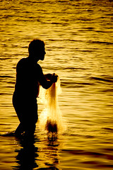 Fisherman (Pillmann) Tags: sunset pordosol sun sol praia beach silhouette canon contraluz gold fishing fisherman 300d sundown 300mm dourado explore canonrebel ouro silhueta pescando peopleschoice superaplus aplusphoto pillmann