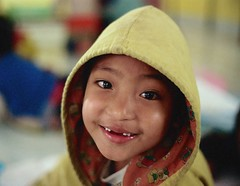 twelve teeth smile :) (janchan) Tags: portrait people children thailand asia retrato burma documentary tailandia orphanage myanmar ritratto reportage goldentriangle chiangrai akha orfanotrofio whitetaraproductions
