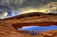 Rising Sun over Mesa Arch (James Neeley) Tags: sunrise landscape canyonlandsnationalpark canyonlands soe hdr mesaarch naturesfinest instantfave 5xp speclandscape colorphotoaward impressedbeauty irresistiblebeauty diamondclassphotographer flickrdiamond jamesneeley