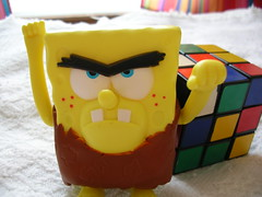 Neanderthal SpongeBob flies into a fit of rage when he realizes that he lacks the mental faculties to solve the Rubik's Cube.
