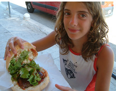 Caterina shows her sandwich with cevapciki (Snazzo) Tags: 2005 mediterranean croatia caterina vis vacanze holyday snazzo