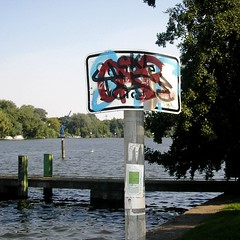 Gehwegschden und Nah am Wasser gebaut (bartholmy) Tags: signs berlin schilder sign graffiti sticker grafitti stickers tags sidewalk schild damage spree treptow aufkleber trottoir treptowerpark brgersteig gehweg gehwegschden obliterated overpainting paintover bermalt bermalung damagestosidewalk