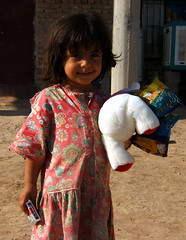 Toys aplenty (YourLocalDave) Tags: iraq girl kids toys humanitarian portrait oif