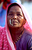 Market Trader - Ram Kund - Nasik - India (Images of India) Tags: travel pink people india maharashtra nosering 50millionmissing noseringthefeminine