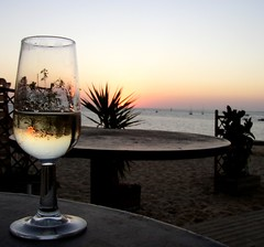 Glass of sherry and a sunset