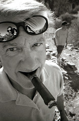 The Senator ([ CK ]) Tags: portrait selfportrait reflection sunglasses mexico outdoors interestingness friend desert brothers bruce cigar baja poloshirt ck xa4 aprticket antiphoto stogie grayhair olympusxa4 tajocanyon