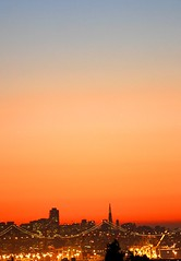 My Small City at Sunset (Thomas Hawk) Tags: sanfrancisco california city bridge sunset orange usa building topf25 topv111 skyline architecture skyscraper oakland downtown cityscape unitedstates 10 unitedstatesofamerica william fav20 financialdistrict baybridge highrise eastbay transamerica fav30 transamericapyramid cityview portofoakland transamericabuilding pereira fav10 williampereira fav25 fav40 williamlpereira pereria superfave