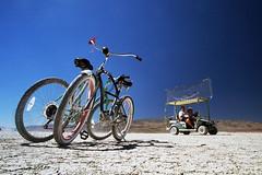 parked bikes + golf buggy (lomokev) Tags: bike canon sand desert bikes burningman blackrockcity cycle dust fahrrad vlo fiets cycles blackrock bicicletta golfbuggy burningman2005 bicis blackrocksands deletetag  roll:name=sfbm2005eosa file:name=sfbm2005eosa23
