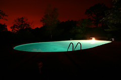 nightpool (Orrin) Tags: longexposure blue topf25 water pool night lenstagged still quiet massachusetts wideangle illuminated creepy spooky swimmingpool ladder 1022mm bluegreen buzzardsbay canonefs1022mmf3545usm moo1 tccomp031 tccomp336