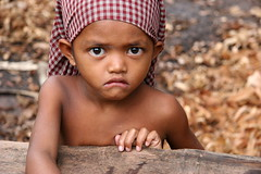Wide-eyed sweetheart (Kalabird) Tags: topv111 children cambodia village angkorwat most temples siemreap hummingbirdxmas banteaysrei kalabirdutatafeature angkorsingle