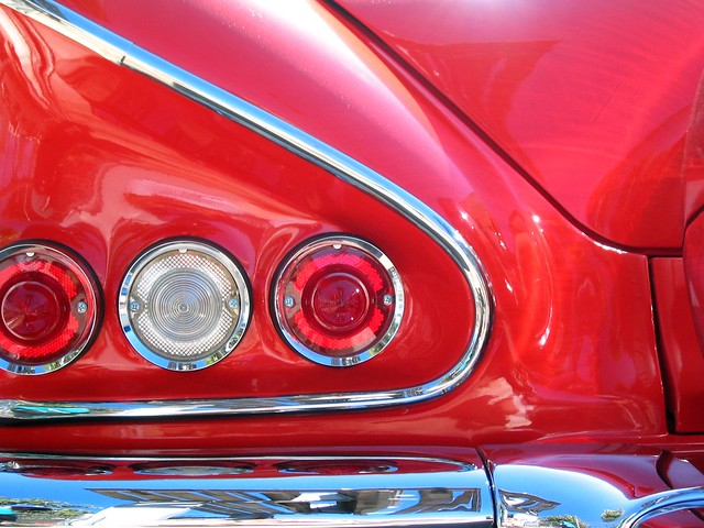 chevy impala red shiny chrome taillight curve abstract bumper reflection sheetmetal city urban street sanfrancisco california mission