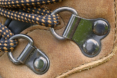 boot up (hangdog) Tags: hikingboot drings steel thread laces checkered chequered shoelace shoe leather tan hitec rivet rivets stitching upper macro 90mm nikon d70 2005