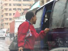 City of Jo'burg : Catching a mini bus taxi (kool_skatkat) Tags: woman donna mujer taxi femme mulher mara frau grua vrouw perempuan muller dona babae    naine kvinne  nainen kobieta koolskatkat  kvinde fminit  ena kvinna kadn n femeie  moteris enska sieviete    phn