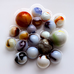 A Flood of Minimal Proportion Sends Water to Marble World's Knees (Andrew Morrell Photography) Tags: marbles glass round shiny orange red blue yellow brown green water white 15fav 510fav favme