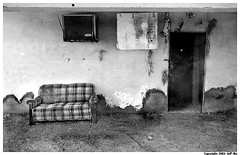 Couch (Jeff T. Alu) Tags: digital black white photoshop couch building old dirty bombay beach surreal moody lonely dark outdoors bleak blackandwhite deserted illusion zen medetation medetate power impact graphic doom bright earthy dirt gritty intense visionary heat passion 4x4 remote california desolate dreamy nightmare euphoric