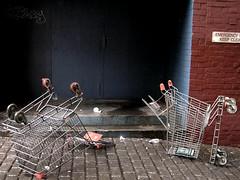 My shopping trolley murdered (Cyron) Tags: 2005 rain geotagged photo garbage flickr urbandecay australia brisbane takenbyme queensland shoppingtrolley pc4000 cyron auspctagged geolat27469782 geolon153026488