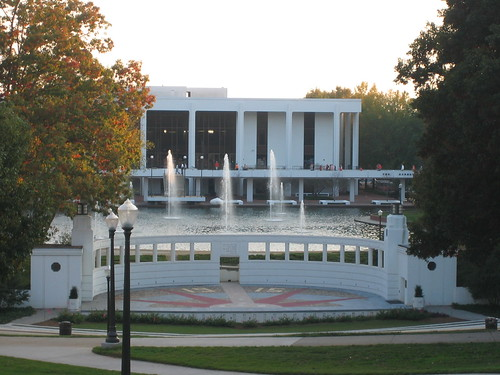 This picture showcases the beautiful Clemson University Library, with a man-made pond and fountain in front of the library enterance.