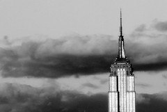 Alone in the Sky (Arnold Pouteau's) Tags: nyc newyorkcity bw newyork building clouds wow manhattan empirestate outsidethewindow 50ms