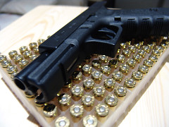 Glock On a Bed Of Bullets (See El Photo) Tags: life 15fav stilllife black metal gold scary dangerous gun many weapon pistol 40 handgun bullets 3f deadly 1000views glock 4f 1f faved 111v1f 1200views bighurt 40calibur stillstill blackgun cankill glock9 gunbullets bedofbullets lotsofbullets bedogbullets