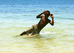 jump! (Farl) Tags: africa blue boy sea beach colors childhood fun coast kid jump frolic gutentag muslim joy sweat innocence madagascar africans malagasy traveltip ramena diegosuarez antsiranana emeraldsea merdemeraude