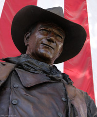 John Wayne (Jim Frazier) Tags: johnwayne california airport bronze statue sculpture statuary october 2005 seminartrip lookingup brown american flag patriotic americana documentation postcard odd humor americanflag patriotism funny hat hats texture mylife q3 orangecounty orangecountyairport sna santaana toorganize ©jimfraziercom nostcblog infrastructure