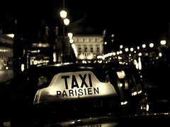 taxi parisien II ([phil h]) Tags: 2005 blackandwhite bw 15fav paris france topf25 topc25 topv111 topv2222 night 1025fav 510fav wow dark topf50 topv555 topv333 topf75 bravo 500plus darkness cab taxi topc50 topv999 topv444 july olympus topv222 illuminated blogged topv777 parisist topf100 topv666 camedia filmnoir topv888 philhilfiker 1000v40f utataliveshere