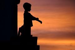 sentinel (lecates) Tags: sunset vacation sky orange holiday silhouette wall clouds mexico interestingness nikon dusk profile ethan explore creativecommons mitchell mayanriviera costamaya jesters quintanaroo interestingness64 d80 18135mmf3556g playadelsecreto explore20070416 jestershof