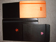 Moleskines-- 3 black moleskines, one orange moleskine