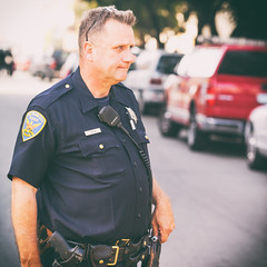 San Francisco Cop (Thomas Hawk) Tags: america california mission missiondistrict sffd sfpd sanfrancisco sanfranciscofiredepartment sanfranciscopolicedepartment usa unitedstates unitedstatesofamerica cop fire policeman spotnews fav10